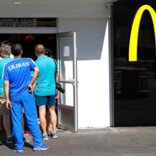 An Iranian athlete lines up at a McDonald's place inside the Olympic village in Rio de Janeiro, Brazil August 1, 2016. REUTERS/Kai Pfaffenbach - RTSKLJQ
