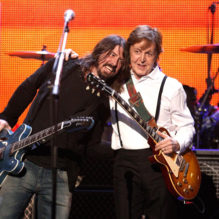 LOS ANGELES, CA - FEBRUARY 10:  Musician Dave Grohl of the Foo Fighters (L) and honoree Sir Paul McCartney perform onstage during The 2012 MusiCares Person Of The Year Gala Honoring Paul McCartney at Los Angeles Convention Center on February 10, 2012 in Los Angeles, California.  (Photo by Christopher Polk/WireImage)