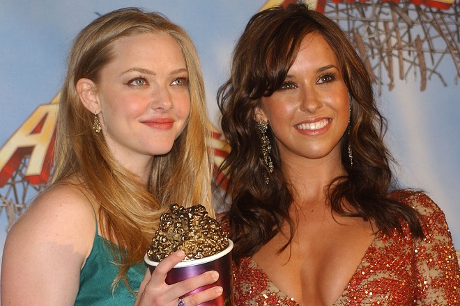 """Amanda Seyfried and Lacey Chabert, winners of On-Screen Team for """"Mean Girls"""" (Photo by Albert L. Ortega/WireImage)"""