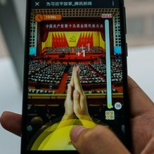 "This photo illustration shows a woman playing a game called ""Clap for Xi Jinping: A Great Speech"", in Shanghai on October 19, 2017. China's ubiquitous WeChat platform has released a game allowing the country's hundreds of millions of smartphone users to retroactively applaud President Xi Jinping's more than three-hour opening speech -- by tapping their phone screens. / AFP PHOTO / CHANDAN KHANNA        (Photo credit should read CHANDAN KHANNA/AFP/Getty Images)"